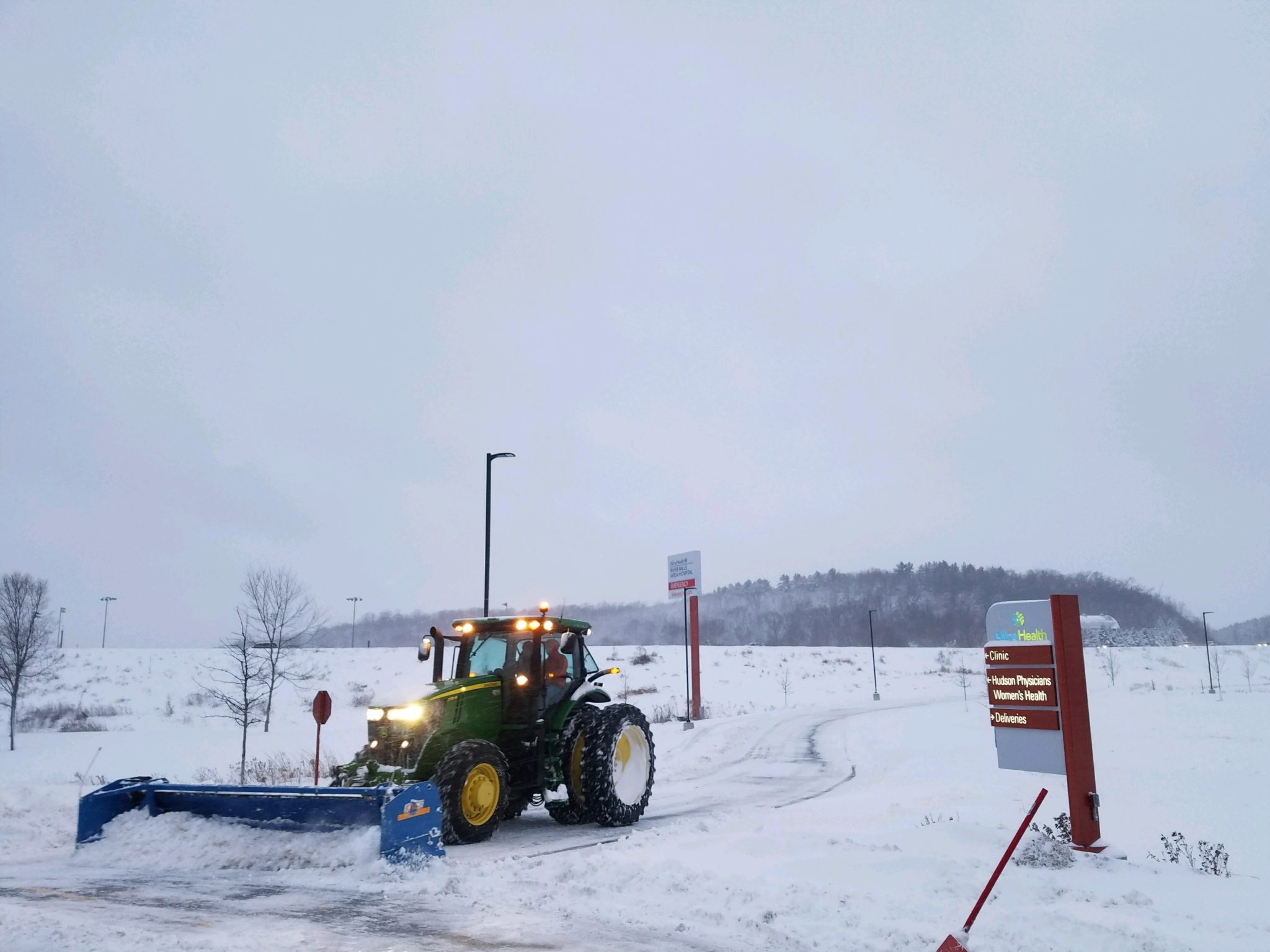Tractor with Snow Plow Attachment
